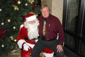 Dr. Nelson giving Santa his Christmas list.